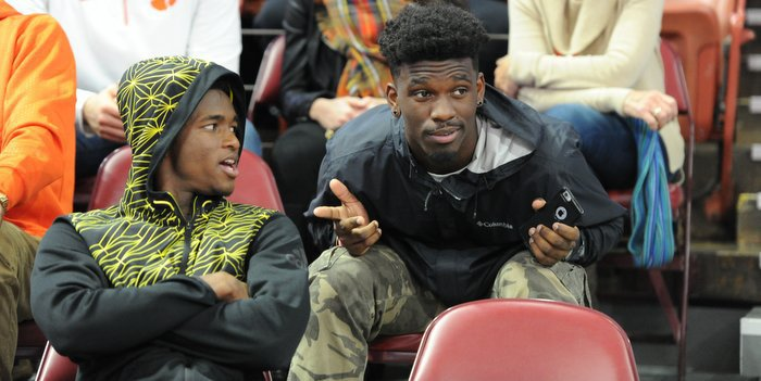 Mullen talks with Tavien Feaster during the basketball game Saturday