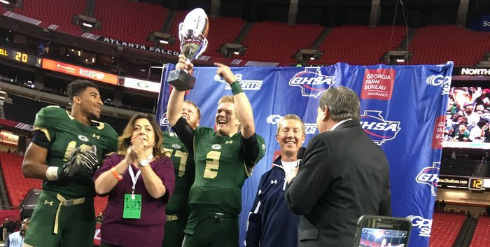 Brice holds the state championship trophy (Photo courtesy of Charlie Conn)