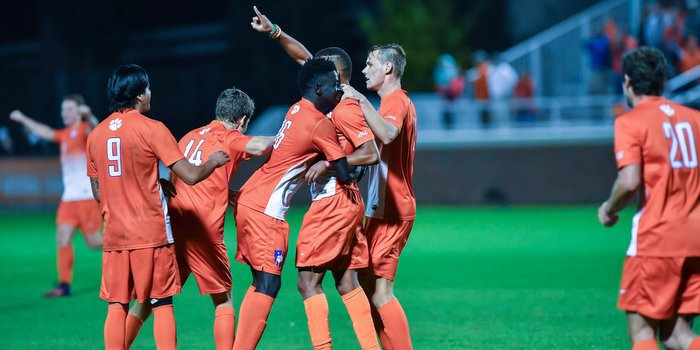 The team celebrates with Happi after his goal (Photo by Carl Ackerman)