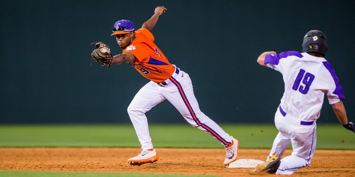 Jordan Greene turns a double play against the Paladins (photo by David Grooms)