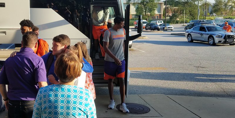 Grantham steps off the bus Friday evening in Clemson