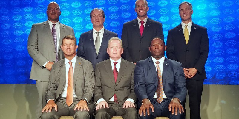 The ACC Atlantic Coaches pose Thursday afternoon