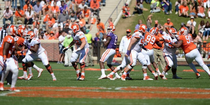 Zerrick Cooper throws a pass in the spring game