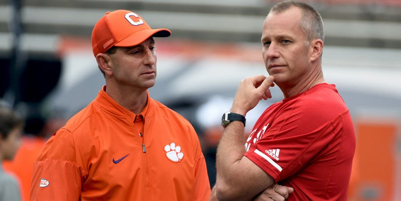 Swinney and Doeren talk before Saturday's Clemson win (Photo by Rob Kinnan, USAT)