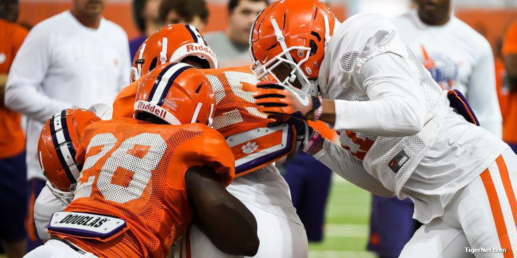 Tavien Feaster runs into a wall of tacklers Tuesday