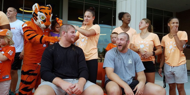 Blake Vinson and J.C. Chalk exchange a smile during Wednesday's head shaving