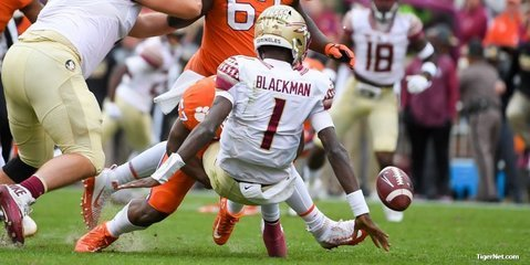 FSU's James Blackman is stripped of the football by Tre Lamar