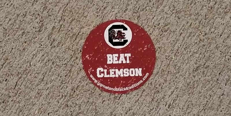 This sticker was stuck to the sidewalk outside the stadium