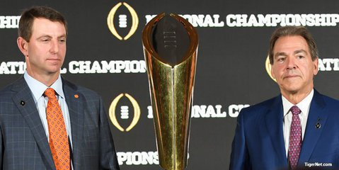 Swinney and Saban pose with the trophy Sunday morning