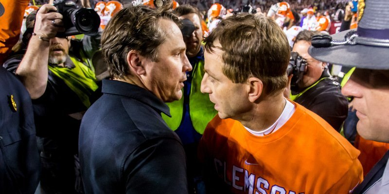Swinney and Muschamp exchange a hug after Saturday's game (Photo by Jeff Blake, USAT)