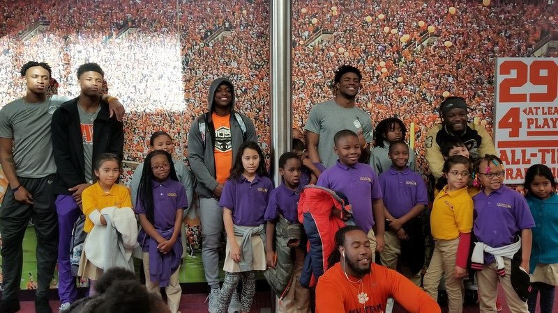 Members of the team pose with some of the kids