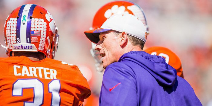 Venables gets in the ear of Ryan Carter during the spring game