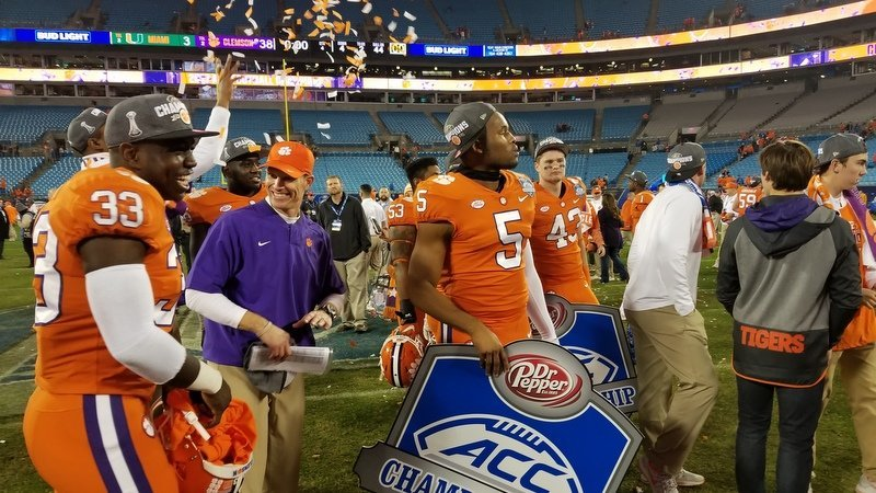 Brent Venables with confetti and his linebackers