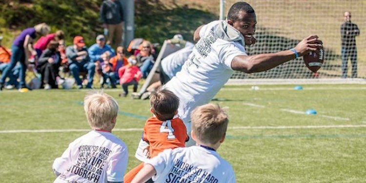 Watson working with the kids at a previous camp