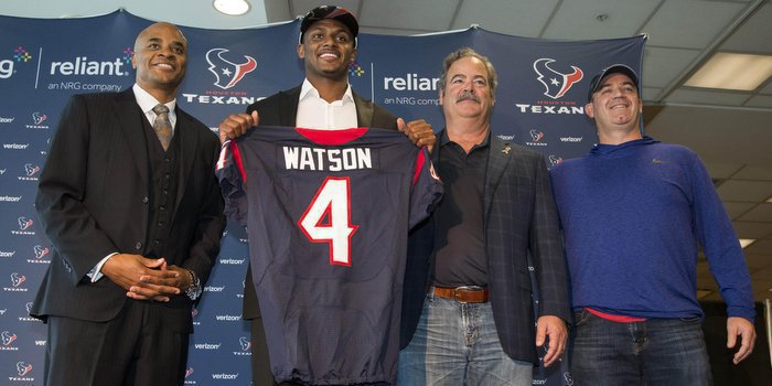 Watson posed with Texans execs last week in Houston (Photo by Troy Taormina USAT)
