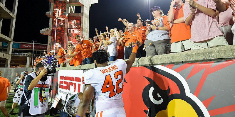 Christian Wilkins celebrates with the crowd after the win