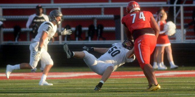 Jackson tosses a defender during a September game against East Lakota
