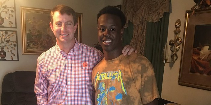 Etienne poses with head coach Dabo Swinney earlier this year