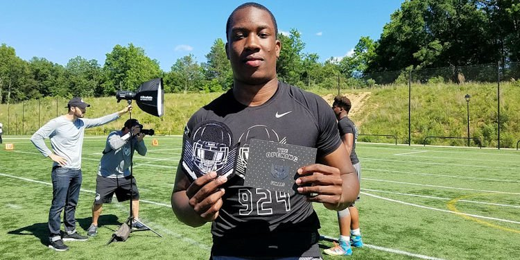 K.J. Henry shows off his Opening invite