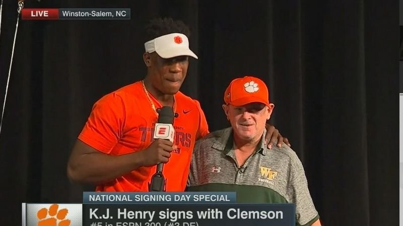KJ Henry shares his moment with Coach Murphy
