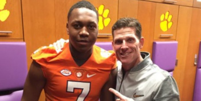 Mascoll poses with Brent Venables two weeks ago