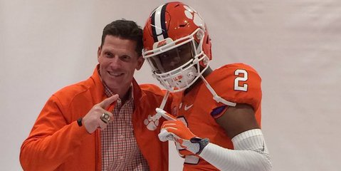 Kyler McMichael poses with defensive coordinator Brent Venables