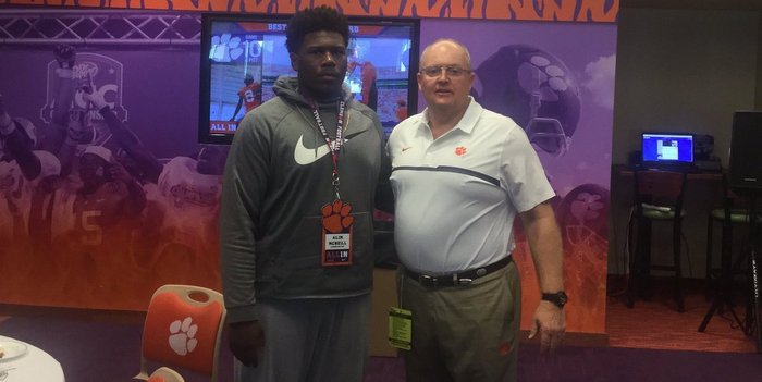 McNeill poses with area recruiter Robbie Caldwell