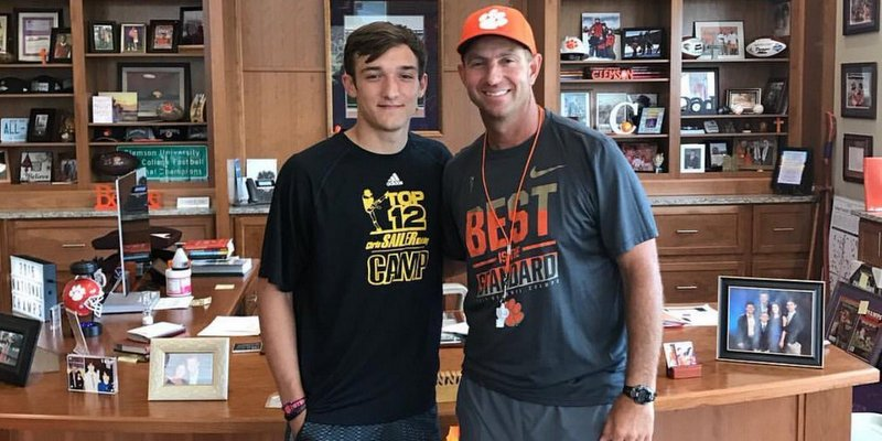 Potter poses with Dabo Swinney after his commitment