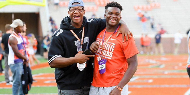 Smith (left) shares a laugh with Clemson commit Mike Jones during pregame Saturday