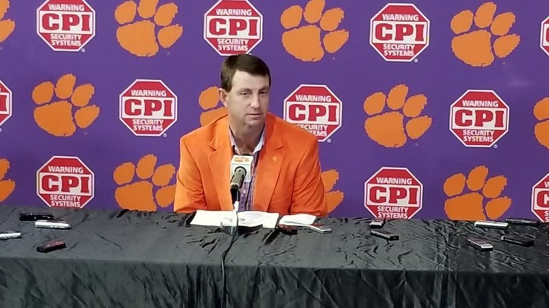 Swinney shows off his orange jacket Wednesday