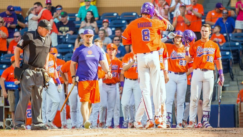 Davidson is greeted at home plate after his grand slam (Photo by Christopher Sloan)