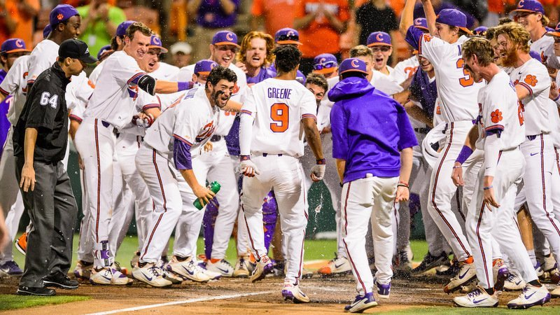 Jordan Greene celebrates with his teammates after the walkoff win (Photo by David Grooms)