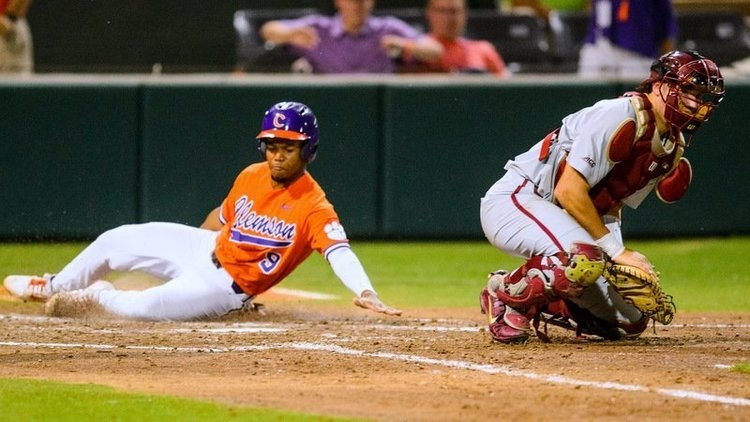 Jordan Greene slides in for Clemson's second run of the night (Photo by David Grooms)