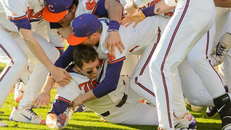 Drew Wharton is mobbed by his teammates after the winning run scored (Photo by David Grooms)