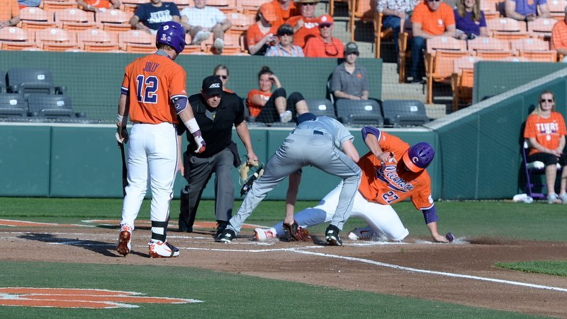 Chris Williams slides in to home with an early run