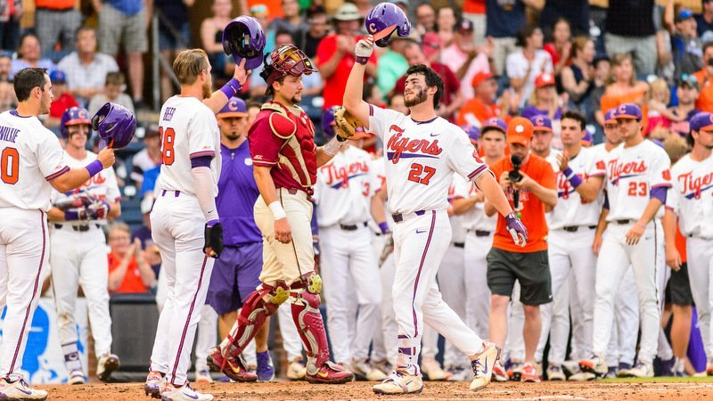 Chris Williams is greeted at home plate after his three-run homer Saturday (Photo by David Grooms)