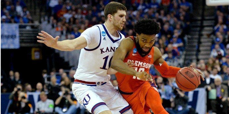DeVoe drives the lane early against Kansas (Photo by Steven Branscombe, USA Today)