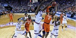 Jayhawks overcome DeVoe's heroics as Clemson's season ends in Sweet 16