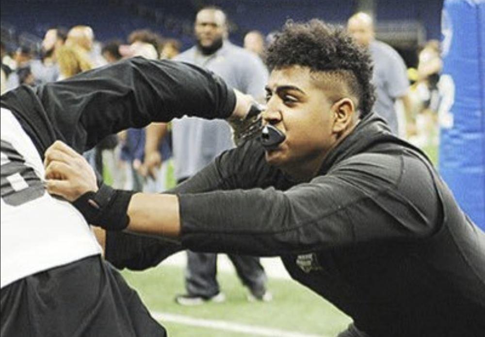 Clemson offers giant OT talent