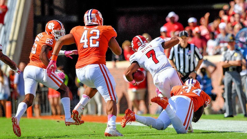 The Tigers chase down a Pack ball carrier two years ago