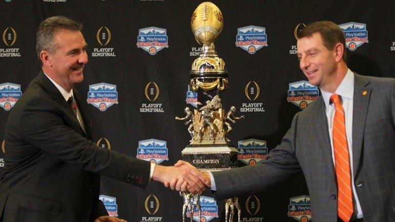Swinney and Urban Meyer shake hands before the Fiesta Bowl