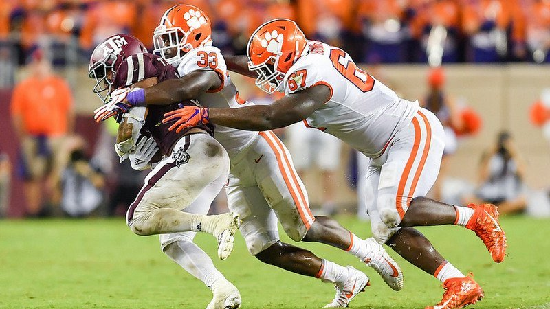 Davis (33) makes the tackle last Saturday at Texas A&M