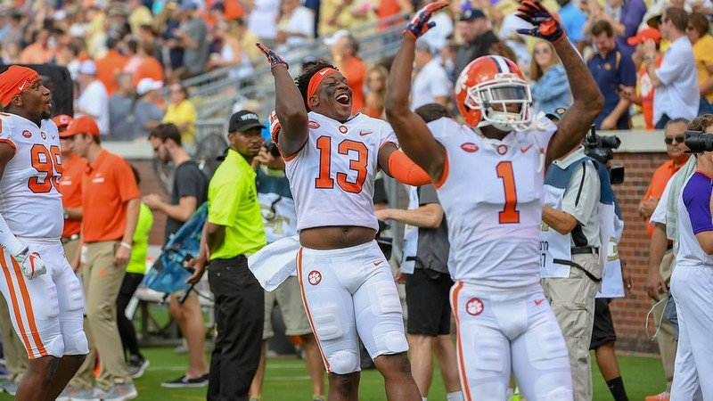 KJ Henry (13) and Trayvon Mullen (1) celebrate the win over Tech
