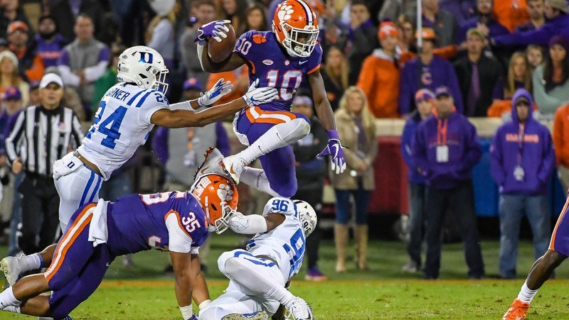 Derion Kendrick hurdles a Duke player in the first half