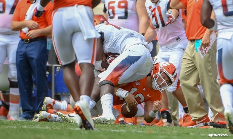 Swinney says he wishes Lawrence would have thrown the ball away