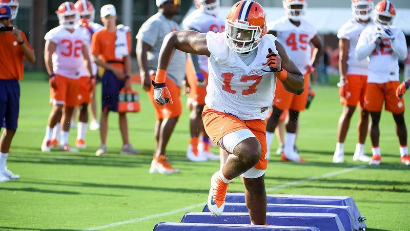 Justin Mascoll works out during practice