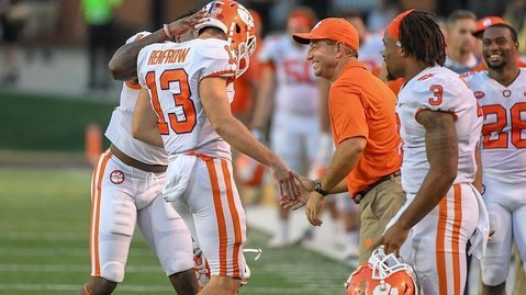 Renfrow (13) gets a big smile from Swinney after punting Saturday