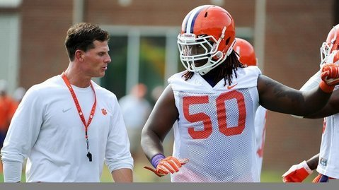 Robinson is shown here with defensive coordinator Brent Venables