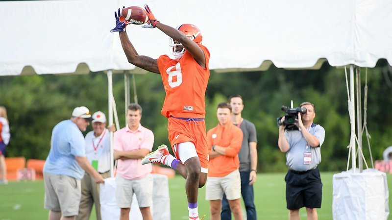 Justyn Ross makes a leaping catch during practice