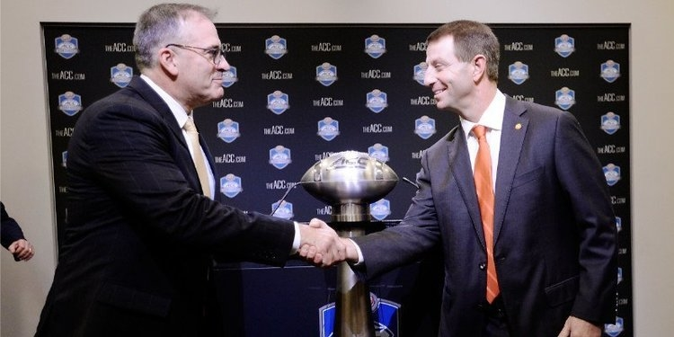 Narduzzi and Dabo Swinney shake hands in Charlotte in 2018 before the ACC title game.